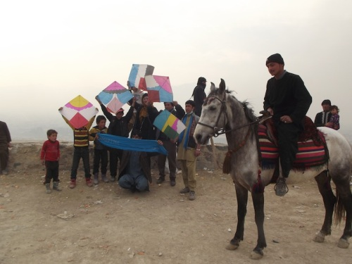 Afghan Peace Volunteers fly kites of a Kabul hillside