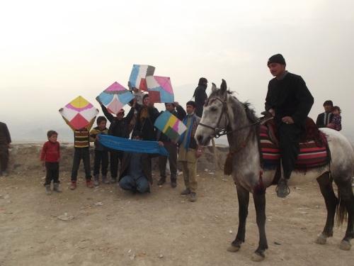 Afghan Peace Volunteers fly kites of a Kabul hillside